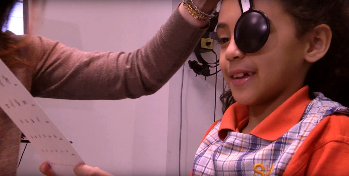 Child taking eye exam