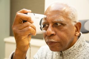 Patient uses tonometer to measure eye pressure_Glaucoma Awareness 2021