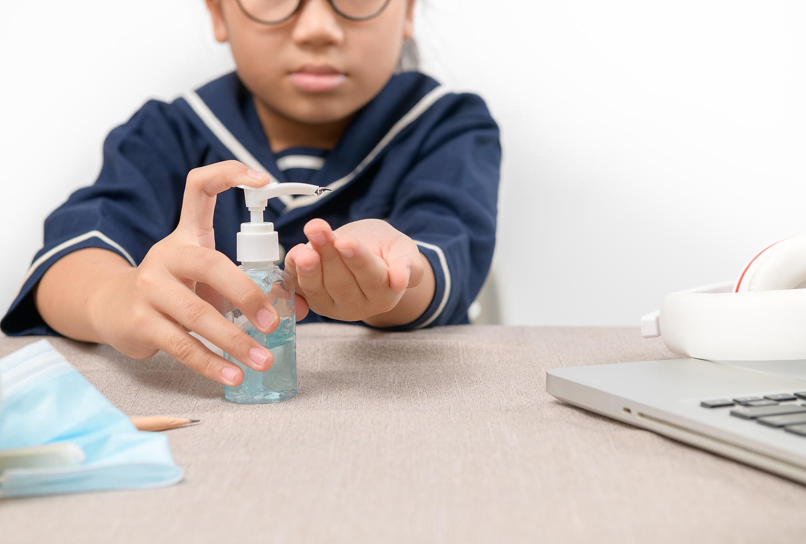 Asian Girl Using Wash Hand Sanitizer Gel Pump Dispenser, Washing