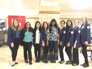 Clarisssa Burroughs (center) with Community Outreach Team Photo