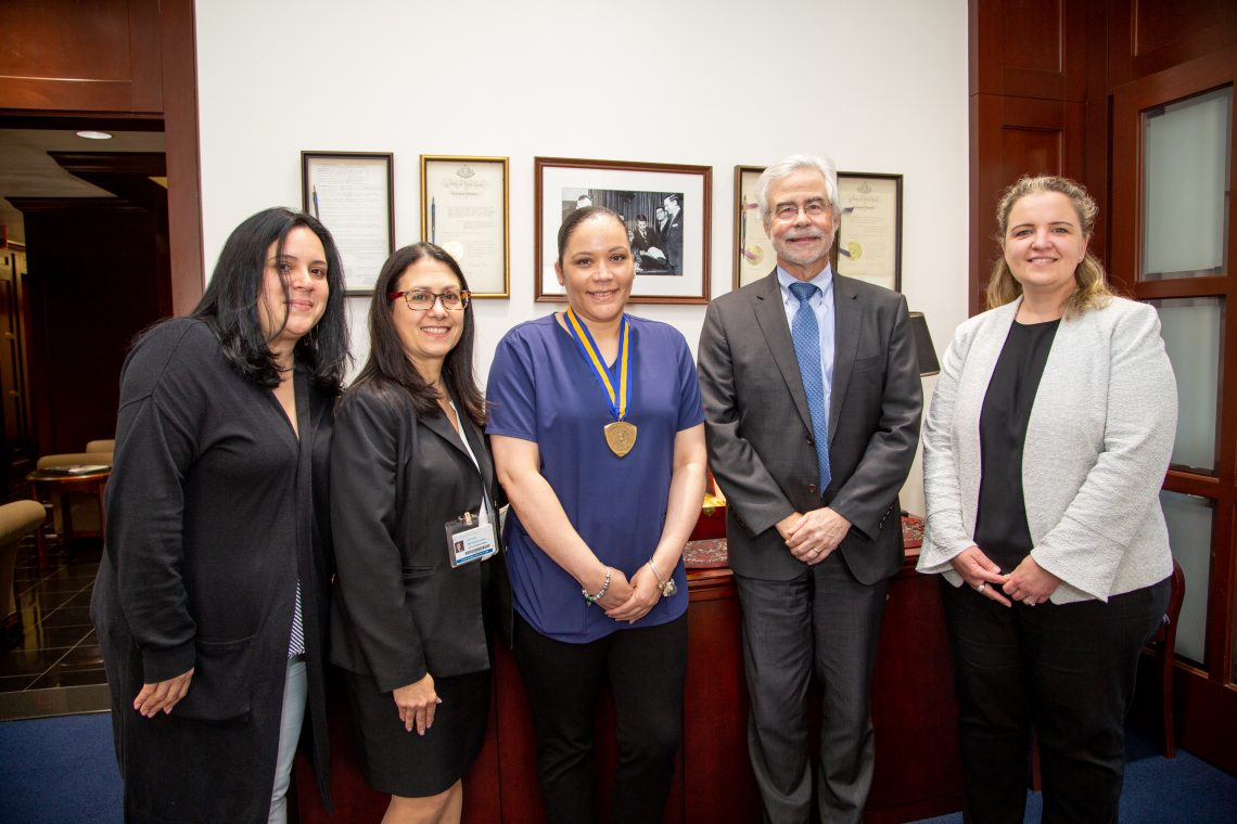 Chancellor's Award for Excellence in Classified Service recipient Kali Berrios (center) with (l-r) Sheryl Carattini, clinic manager for contact lens and pediatric services; Liduvina Martinez-Gonzalez, executive director of the University Eye Center; Dr. David A. Heath, SUNY Optometry president; Dr. Eva Duchnowski, associate clinical professor and contact lens section chief, June 5, 2019.