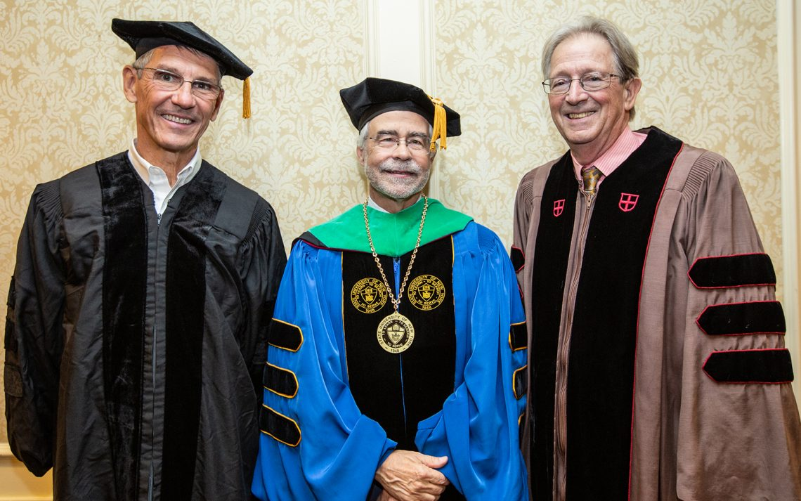Essilor chairman Hubert Sagnières, SUNY Optometry president David A. Heath and Columbia University professor Dr. Donald Hood during the College's 45th commencement, The Roosevelt Hotel, Manhattan, May 23, 2019